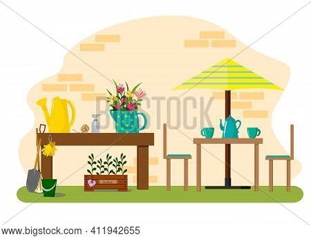 A Tent In The Garden, Gardening Tools And A Box Of Herbs. Garden Table, Watering Can, Jug With Bouqu