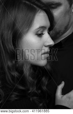 Young Man And Woman Embrace Tenderly. Love And Tenderness. Black And White Photo. Close-up.