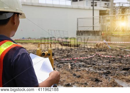 Surveyor Engineer Using An Altometer To Check The Construction Level