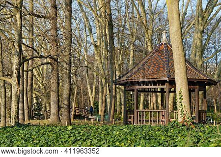 A Kiosk Among The Grass And Tress Of The Park. Parc De La Tete D'or Is One Of The Larger City Park I