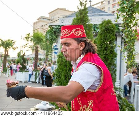 Moscow, Russia, September 01, 2019: A Man In Turkish National Costume Sells Ice Cream On A City Stre