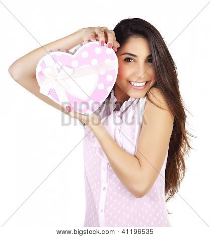 Image of pretty woman with pink present box isolated on white background, attractive female holding in hands gift heart-shaped, Valentine day, romantic holiday, love concept