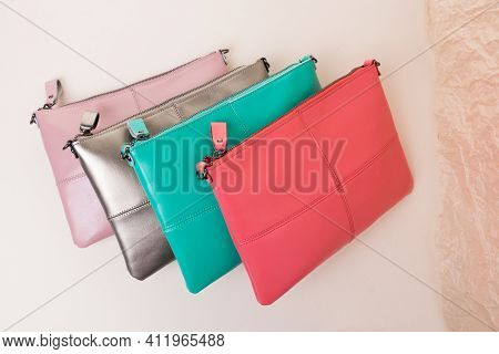 Four Clutches Of Different Colors Pink, Silver, Turquoise, Scarlet. Made Of Genuine Smooth Leather.