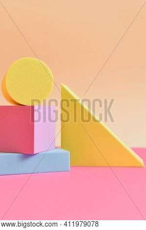 Pink And Yellow Abstract Background With Three-dimensional Geometric Shapes In Pastel Colors. Select