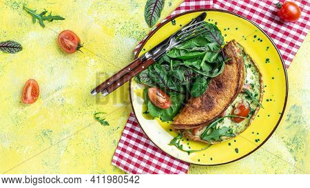 Breakfast Frittata Made Of Eggs, Cheese And Spinach Salad. Frittata - Italian Omelet On A Yellow Pla