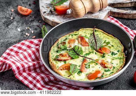 Tasty Italian Vegetarian Breakfast Fried Eggs Frittata Ot Omelete With Mozarella Cheese, Arugula And