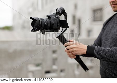 Videography, Filmmaking, Hobby And Creativity Concept - Close Up Of Modern Dslr Camera On 3-axis Gim