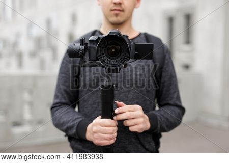 Videography, Filmmaking And Creativity Concept - Videographer Shooting Video Using Modern Dslr Camer