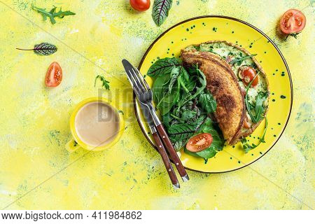 Frittata Italian Omelette With Tomatoes, Cheese And Green Herbs And A Cup Of Coffee On A Yellow Plat