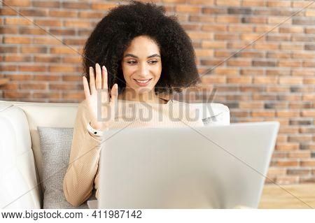 Beautiful African American Girl With Voluminous Dark Hair, Student Involved In Interesting Online Di