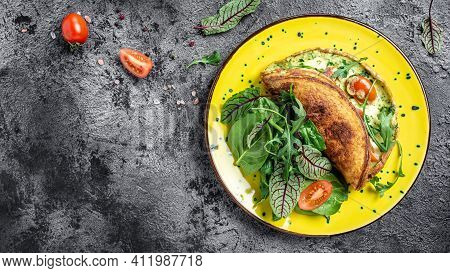Breakfast Frittata Made Of Eggs, Cheese And Spinach Salad On A Yellow Plate On A Gray Background. Ke