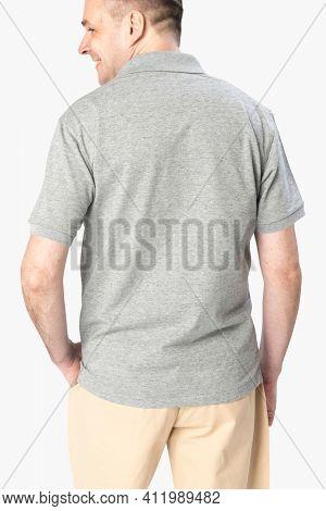 Man wearing basic gray polo shirt apparel rear view