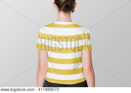 Girl in yellow striped tee teen's summer apparel shoot rear view