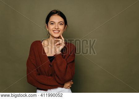 Thinking Beautiful Young Woman Looking To The Side At Green Copyspace. Funky Caucasian Smiling And J