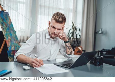 Portrait Of A Young Man In Office And His Professional Occupation As A Photographer. Male Photograph