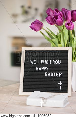 Spring Concept. Bouquet Of Purple Tulips Flowers And Letter Board With The Words We Wish You  Happy