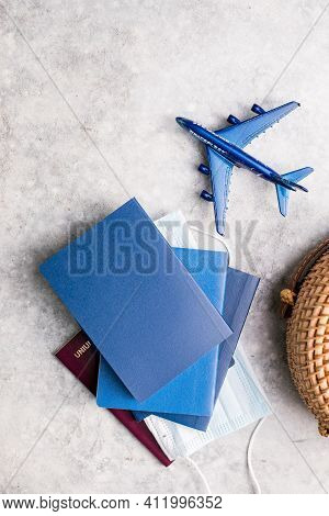 Tourism Travel Concept. Travel Passport And Cosmetic Products For Tanning Or Sun Protection. Prepari
