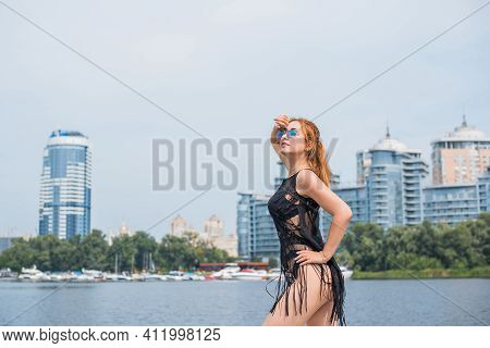Image Of Young Amazing Red Hair Attractive Girl In Sunglasses Wearing Black T-shirt With Fringe On T