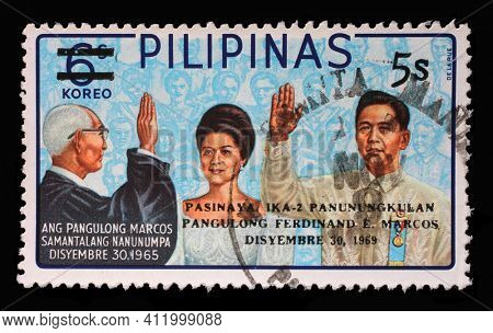 ZAGREB, CROATIA - SEPTEMBER 18, 2014: Stamp printed in Philippines shows Ferdinand Marcos Inauguration, 2nd-term inauguration of president Marcos, circa 1969