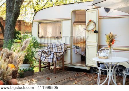 Wooden Rv House Porch With Garden Furniture. Decor Summer Yard. Campsite In Garden. Interior Cozy Ya