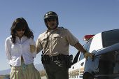 Police man arresting young woman on road poster