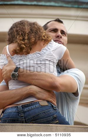 Handsome Proud Man Hugging Woman Close On Balcony