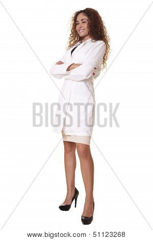 Female Physician Smiles While Standing With Arms Crossed.