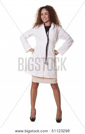 Female Physician Smiles While Standing Like A Superhero.