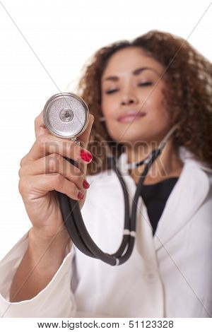 Female Doctor Holds A Stethoscope Out To Her Patient.