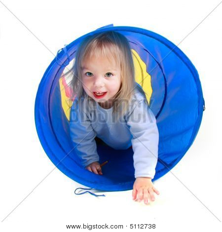 Cute Toddler Girl Playing In Colorful Tube Over White