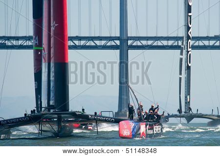 SAN FRANCISCO, CA - SEPTEMBER 12: Emirates Team New Zealand crew waves to crowd after winning their  America's Cup race in San Francisco, CA on September 12, 2013