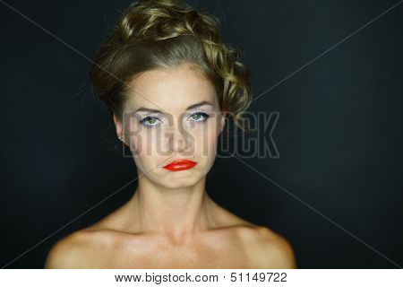 Portrait of a woman with look of verjuice on a dark background