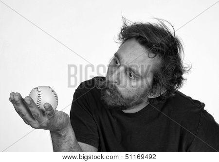 Crazed Baseball fan studying a Foul Ball on White Background