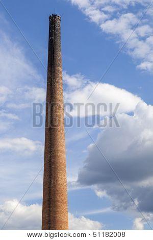 Old industrial brick chimney