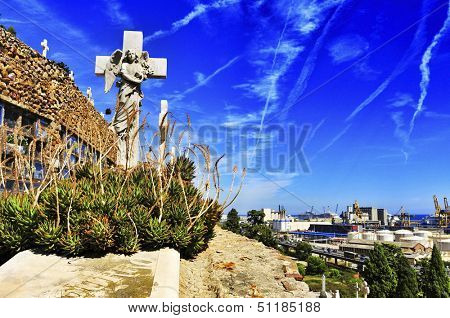view of Cementiri del Sud-oest or Montjuic Cemetery in Barcelona, Spain, with the port in the background
