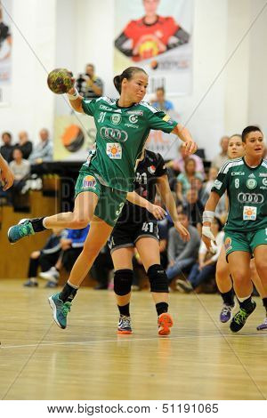 SIOFOK, HUNGARY - SEPTEMBER 14: Agnes Hornyak (green 31) in action at a Hungarian Championship handball match Siofok KC (black) vs. Gyori Audi ETO KC (green), September 14, 2013 in Siofok, Hungary.