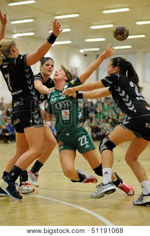 SIOFOK, HUNGARY - SEPTEMBER 14: Adrienn Orban (in green) in action at a Hungarian National Championship handball match Siofok KC (black) vs. Gyor (green), September 14, 2013 in Siofok, Hungary.