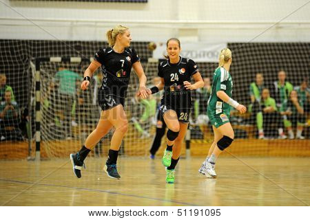 SIOFOK, HUNGARY - SEPTEMBER 14: Siofok players celebrate at a Hungarian National Championship handball match Siofok KC (black) vs. Gyori Audi ETO KC (green), September 14, 2013 in Siofok, Hungary.