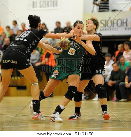 SIOFOK, HUNGARY - SEPTEMBER 14: Eduarda Amorim (in green) in action at a Hungarian Championship handball match Siofok KC (black) vs. Gyori Audi ETO KC (green), September 14, 2013 in Siofok, Hungary.
