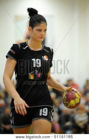 SIOFOK, HUNGARY - SEPTEMBER 14: Dora Deaki (in black) in action at a Hungarian National Championship handball match Siofok KC (black) vs. Gyor (green), September 14, 2013 in Siofok, Hungary.