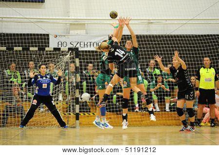 SIOFOK, HUNGARY - SEPTEMBER 14: Unidentified players in action at a Hungarian Championship handball match Siofok KC (black) vs. Gyori Audi ETO KC (green), September 14, 2013 in Siofok, Hungary.
