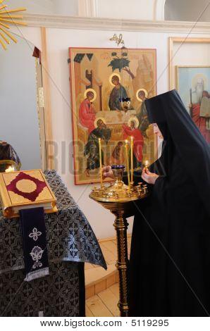 Nun In The Church