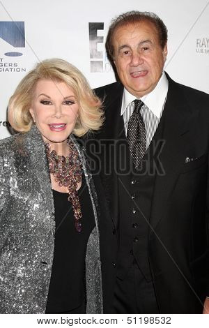 LOS ANGELES - SEP 19:  Joan Rivers, Larry Thompson at the Heller Awards 2013 at Beverly Hilton Hotel on September 19, 2013 in Beverly Hills, CA