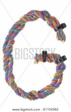 Colorful wire in the shape of the letter G