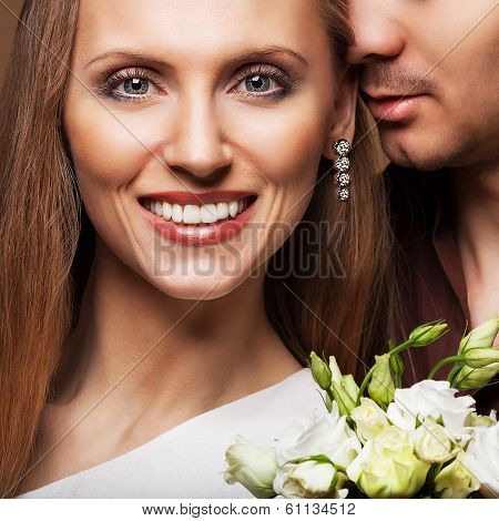 Couple In Love With A Bouquet Of Flowers Are Close To Each Other. Merriage In Love.
