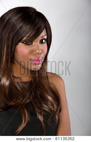beautiful young african woman with long hair on studio background