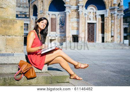 Female College Student Reading At University