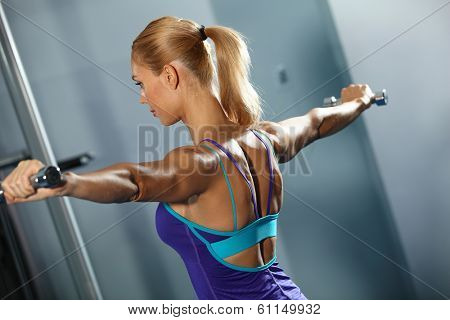 Image of fitness girl in gym exercising with dumbbells poster