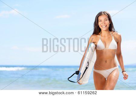 Woman surfer girl beach. Sexy woman surfer girl body surfing on beach. Beautiful woman laughing having fun bodyboarding under sun and blue sky during summer travel vacation, Maui, Hawaii, USA.