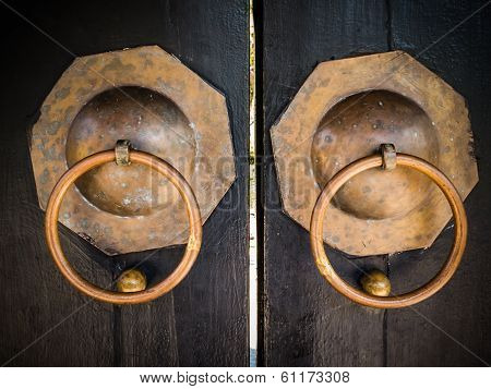 Old Door handles with old wooden close up poster